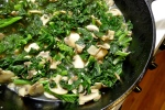 Braising the kale.