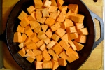 Toss the sweet potato cubes in coconut oil, salt, and pepper.