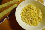 Slice off the kernels into a shallow dish.