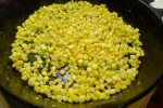 When they begin to toast and a few kernels start to pop, remove them from the pan.