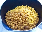 Before covering the soaked and drained chickpeas with water, toss them with baking powder.