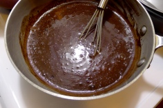 Stir until the cocoa powder is incorporated and the mixture is glossy.